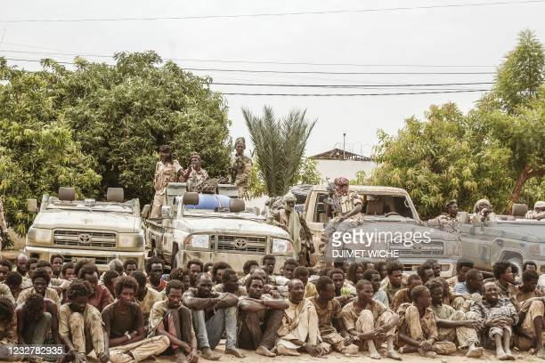 Group of captured rebels from the FACT are displayed together with their confiscated weapons and vehicles at the headquarter of the Chadian Army in...