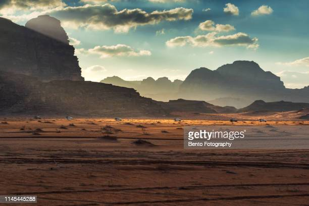 group of caravan in wadirum desert, jordan - jordan middle east stock pictures, royalty-free photos & images