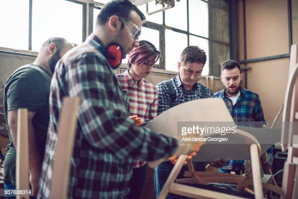 Group of Carpenters Learning How to Use a CNC Machine