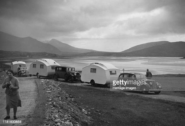 Group of cars and caravans camping in Scottish Highlands 1930's. Creator: Unknown.
