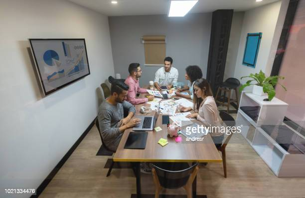 Group of casual business people sharing ideas in a meeting