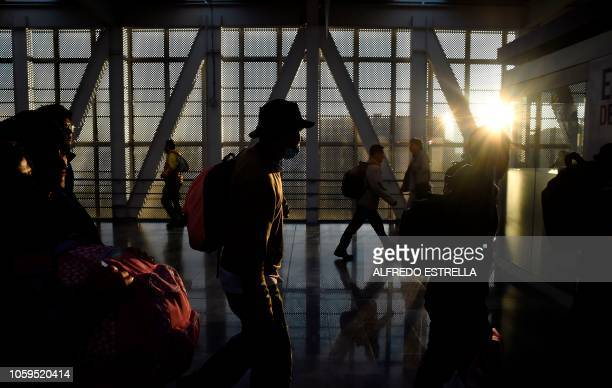 A group of Central American migrants heading in a caravan to the US walks at Cuatro Caminos metro station in Mexico City on their way to Queretaro...