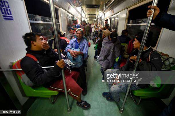 TOPSHOT A group of Central American migrants heading in a caravan to the US is seen on the metro from Ciudad Deportiva to Cuatro Caminos station in...