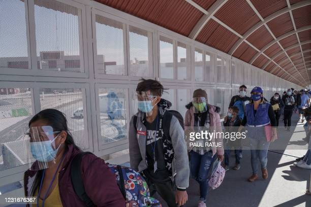 Group of Central American migrants that were flown in from south Texas to be deported to Ciudad Juárez stand by the Pasó del Norte International...
