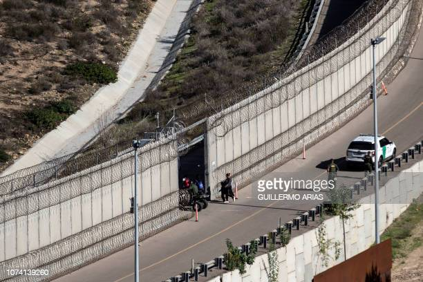 A group of Central American migrants travelling in a caravan is taken in to custody by US Border Patrol after crossing the MexicoUS border fence to...