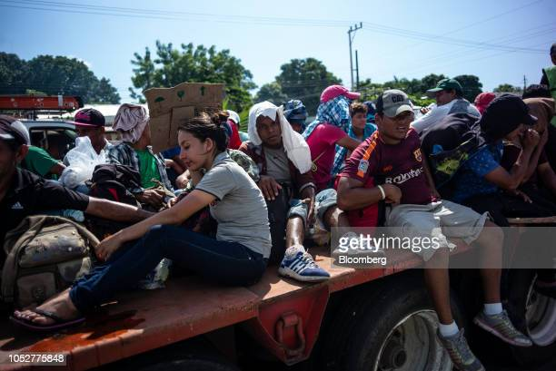 A group of Central American refugees and asylum seekers ride on the trailer of a truck in the town of Tapachula Chiapas state Mexico on Monday Oct 22...