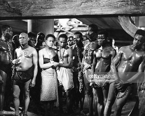 A group of chained African slaves on board a slave ship in a publicity still for 'Song Of Freedom' directed by J Elder Wills 1936