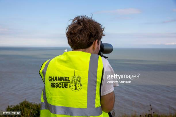 Group of Channel Rescue volunteers monitor the English Channel using telescopes and binoculars searching for small boats of people migrating across...
