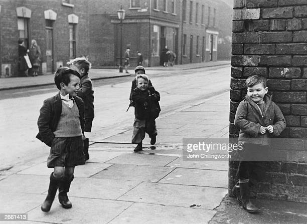 A group of cheeky children playing in the streets of Belfast Original Publication Picture Post 7029 The Best And The Worst Of Some British Cities 5...
