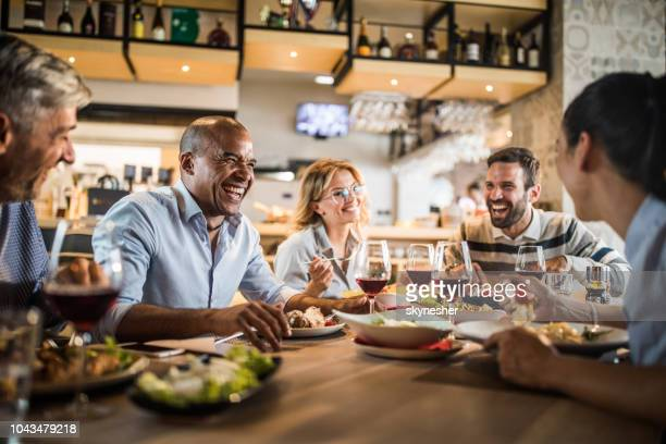 group of cheerful business people having fun on a lunch. - restaurant stock photos and pictures