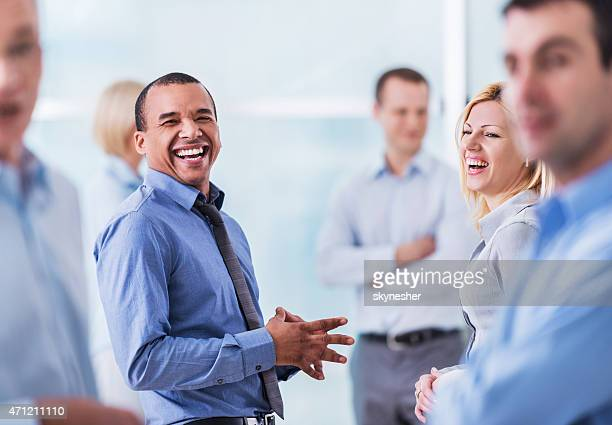 Group of cheerful business people laughing.
