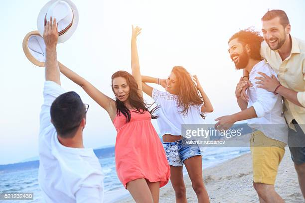 Group of cheerful friends enjoying the summer vacations