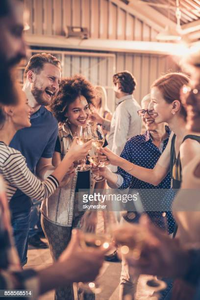 group of cheerful people toasting with wine on a party. - celebration event stock photos and pictures