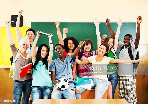 Group of cheerful students looking at the camera