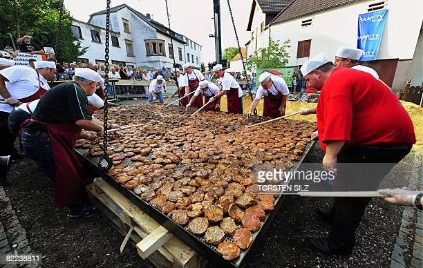 A group of chefs attempt to beat the world record in barbecuing steaks in the southern German town of BubachCalmesweiler on August 9 2008 The chefs...