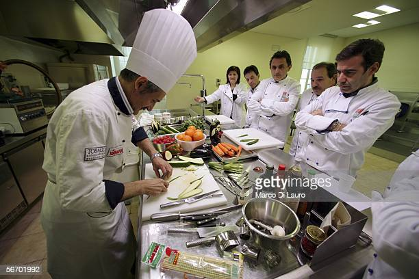 A group of chefs watch Master Chef Ottaviano Pellini of Il Pontino Restaurant in Porto Potenza Piceno as he prepares fruit and vegetable during a...