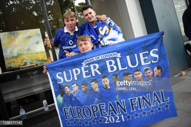 Group of Chelsea supporters pose for a photograph near Stamford Bridge stadium in the build-up to the UEFA Champions League final football match...