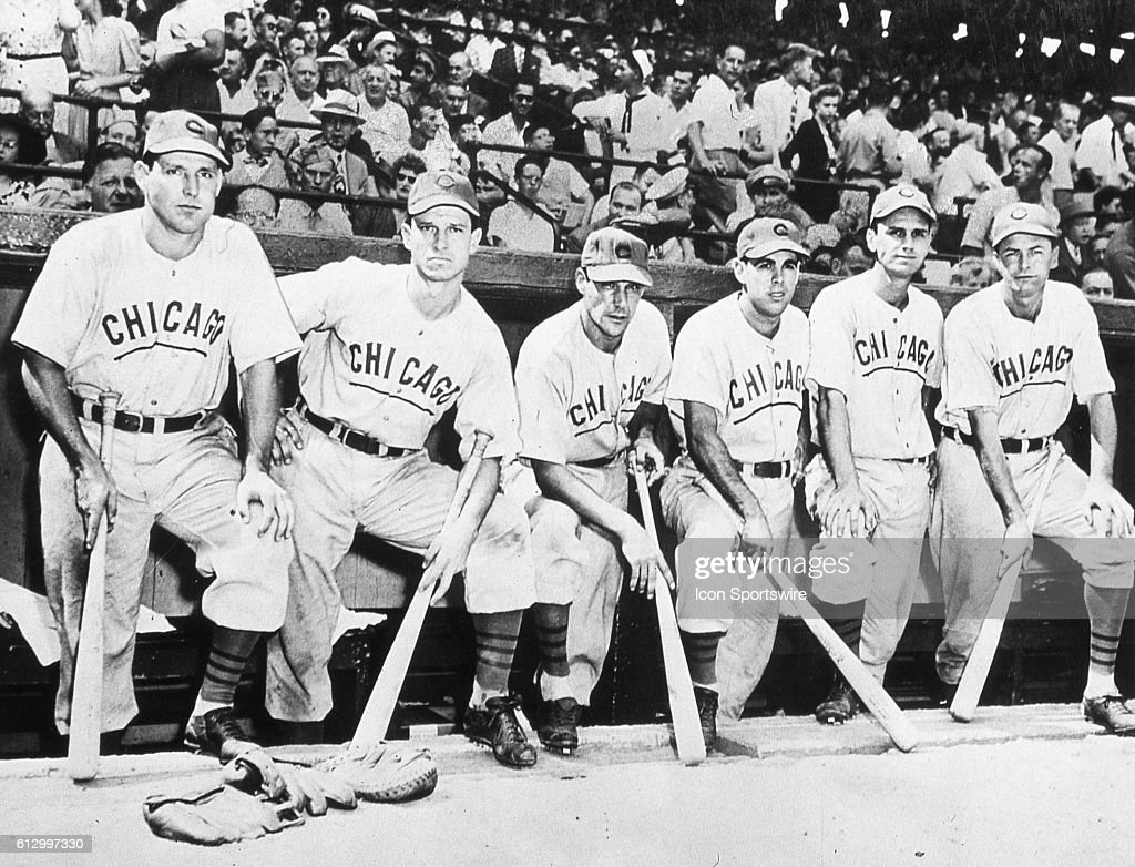 CHICAGO, IL - OCTOBER 6, 1945. A group of Chicago Cubs pose in their dugout in Wrigley Field on October 6 before the start of game four of the 1945 World Series. These Cubs are (L-R) Swish Nicholson, Andy Pafko, Phil Cavaretta, Peanuts Lowrey, Don Johnson, and Stan Hack.