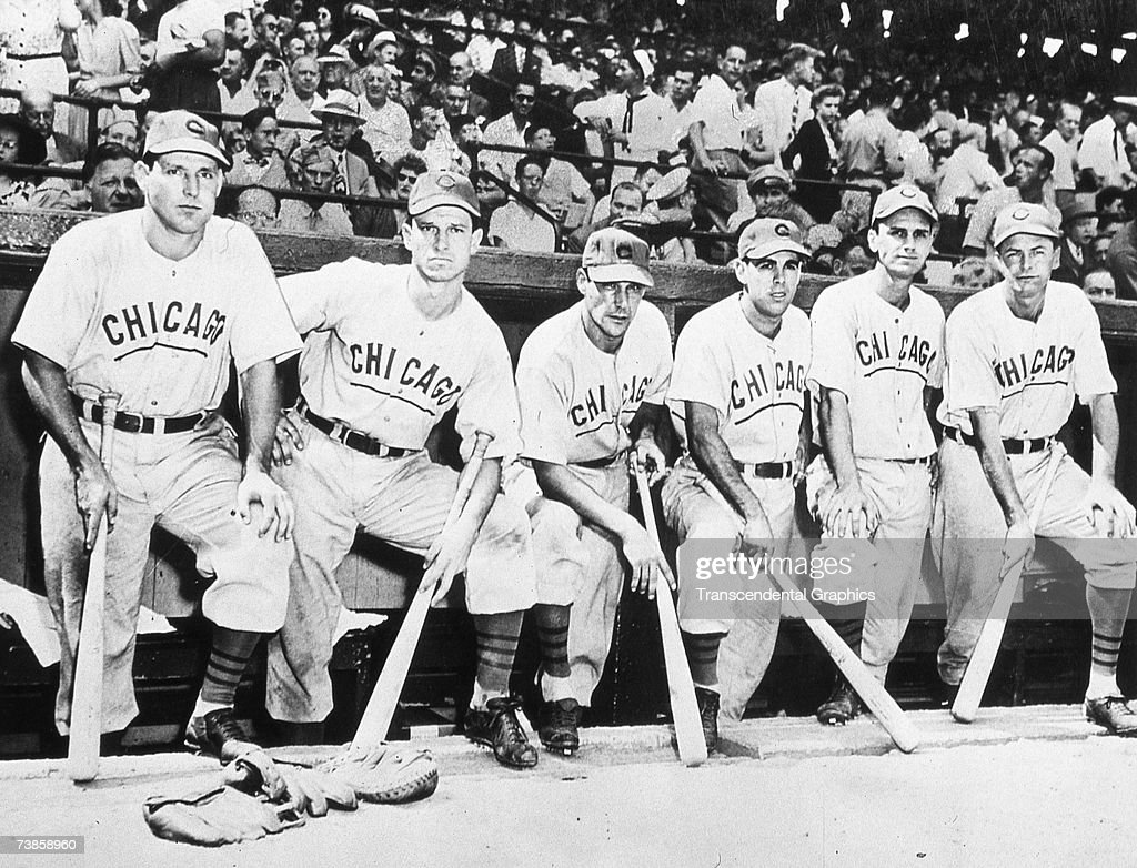 CHICAGO - OCTOBER 6, 1945. A group of Chicago Cubs pose in their dugout in Wrigley Field on October 6 before the start of game four of the 1945 World Series. These Cubs are (L-R) Swish Nicholson, Andy Pafko, Phil Cavaretta, Peanuts Lowrey, Don Johnson, and Stan Hack.