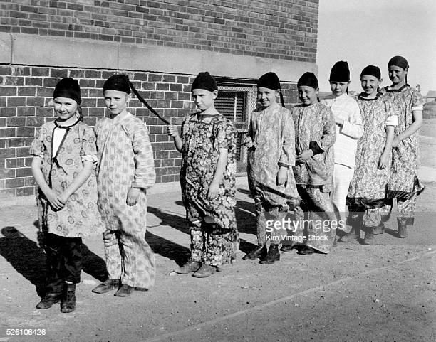 Group of children appear to be dressed up as Chinese men, ca. 1919