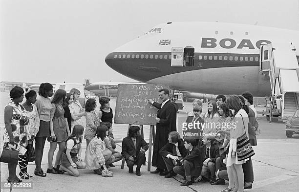 Group of children are given an instructional talk about a BOAC Boeing 747, followed by a short flight, UK, 4th July 1971.