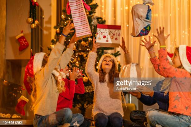group of children are happy because christmas presents - santa face stock pictures, royalty-free photos & images