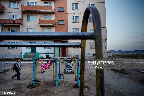 Group of children are playing together outside of their apartments in the Sharyngol district of Mongolia where businesses were built around the...
