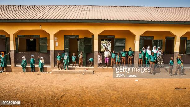 A group of children are seen standing outside their classrooms at a school in the remote village of Kpalong Kpalong is 50kms outside Tamale in...