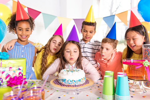 group of children at birthday party at home 1074986054