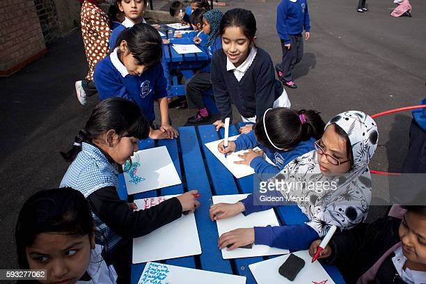 A group of children at Marner Primary School in Tower Hamlets sit at the writing and drawing tables during their playtime This is one of the schools...
