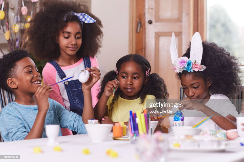 A group of children doing Easter Egg painting. : Stock Photo