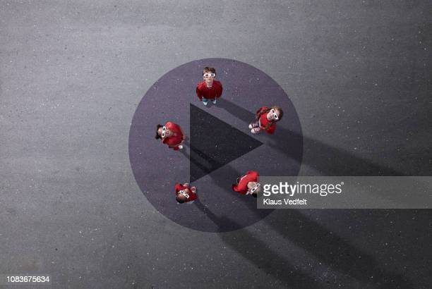 group of children dressed in red standing on video player icon, wearing 3-d glasses - people icons stock pictures, royalty-free photos & images