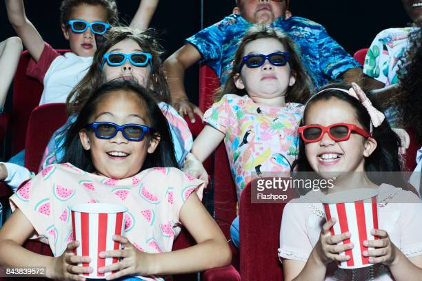Group of children enjoying a movie at the cinema