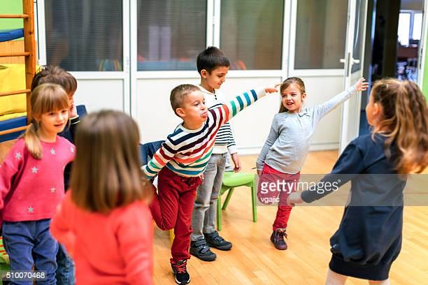 Group of children exercising in kindergarten.