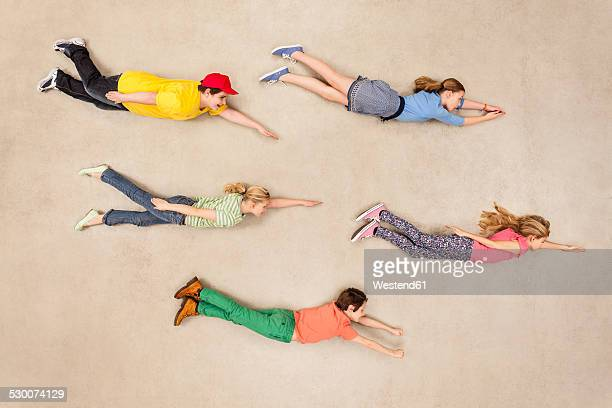 Group of children flying in the same direction