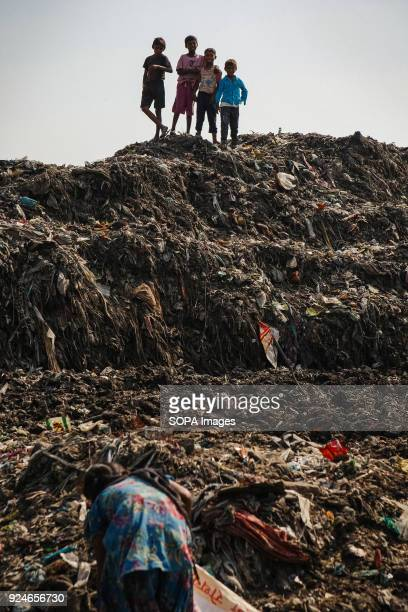 A group of children from the slum seen spending their afternoon playing on a pile of rubbish Over 25 million people live in Delhi India What is...