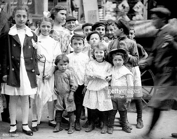 Group of children gather around to have their picture taken on the Lower East Side of New York.