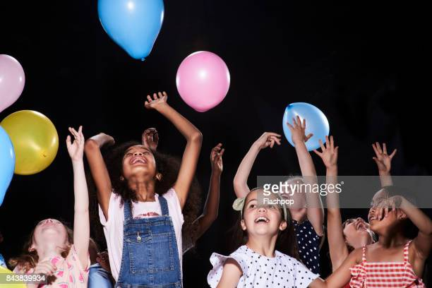 Group of children having fun at a party