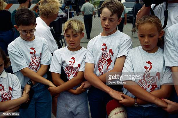 A group of children hold vigil for family and friends lost in the Oklahoma City bombing as they watch the remains of the Alfred P Murrah building be...