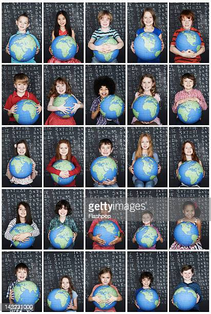 Group of children holding a globe in class