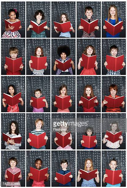 Group of children holding book in class