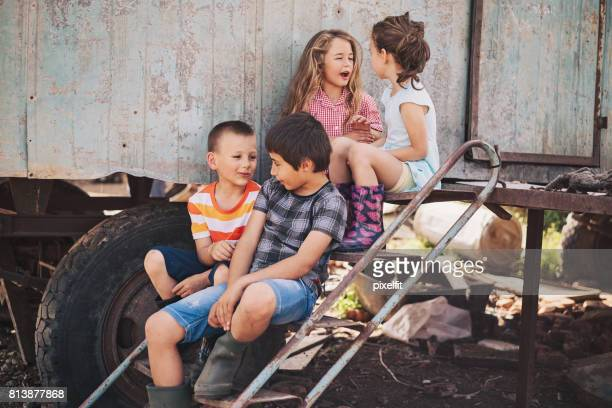 group of children in a ghetto - ghetto trash stock pictures, royalty-free photos & images