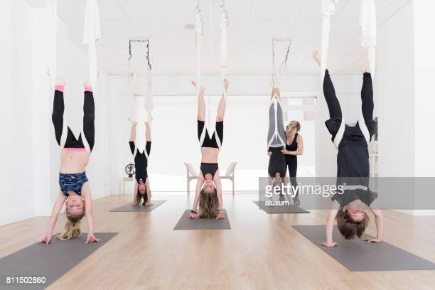 Group of children in aerial yoga class