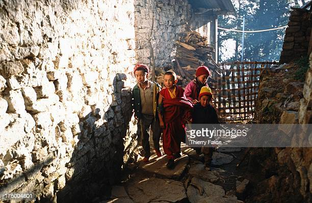 A group of children in an alley of the Tawang monastery