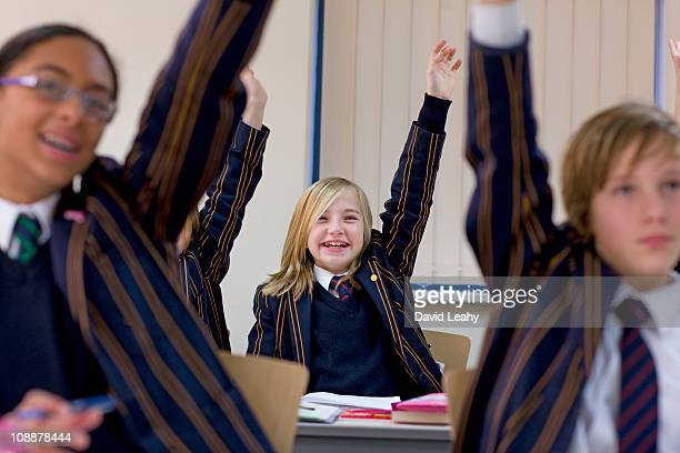 group of children in school - school uniform stock pictures, royalty-free photos & images