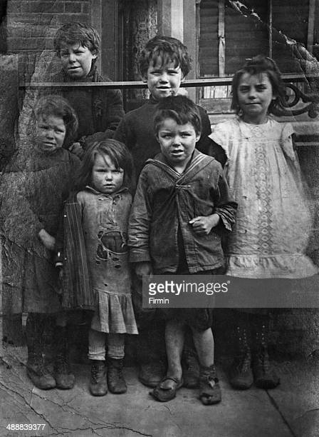 A group of children including sevenyearold Charles Jarrard who accidentally shot his mother Rose Jarrard dead with a revolver in Ilford Essex 20th...