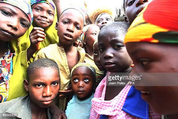 A group of children jostle for position in front of the camera on November 07 2009 in Bauchi Nigeria
