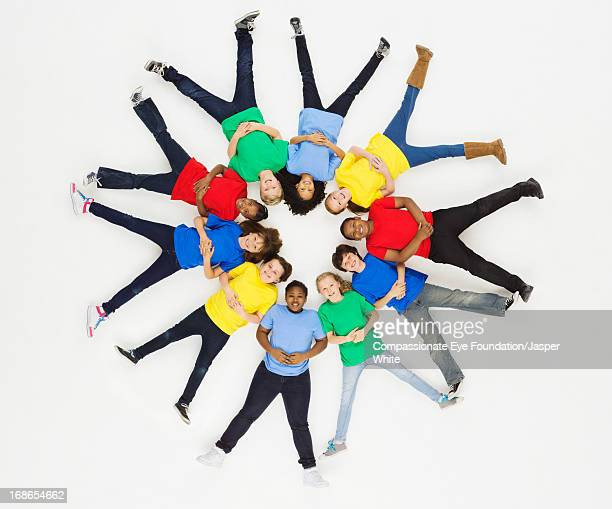 Group of children laying in circle formation