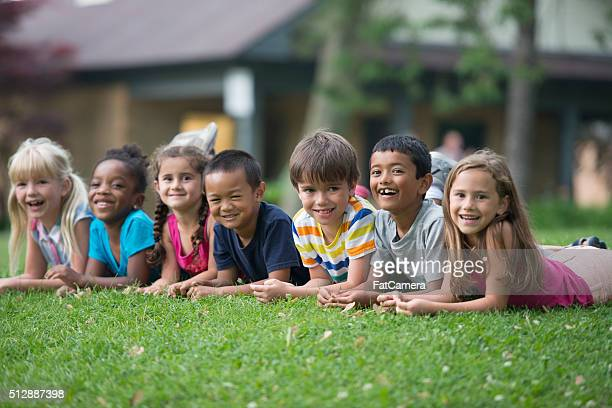 group of children lying in a row - hot indian girls stock photos and pictures