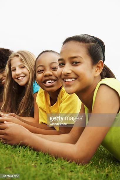 Group of children lying on grass